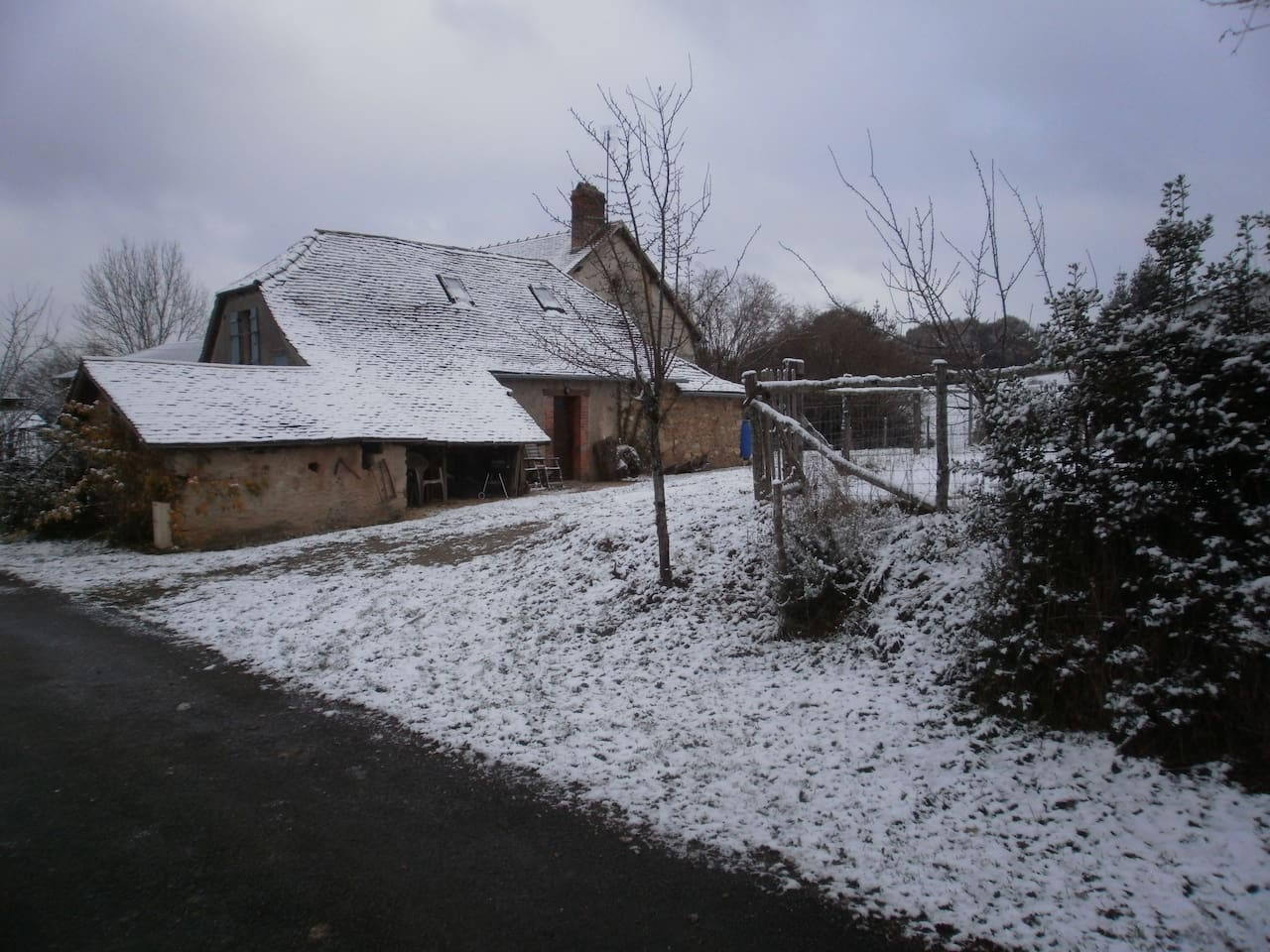 Le Petit Cottage in the snow but cosy and warm inside.