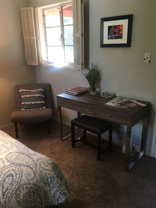 Seating and desk in bedroom