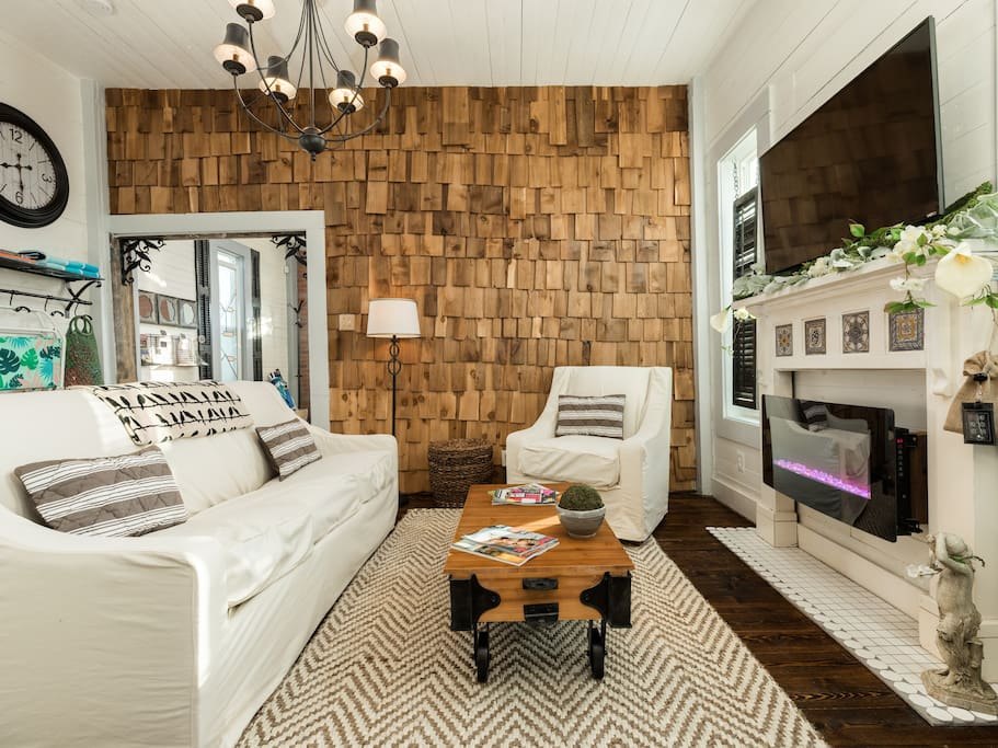 A cedar shingle wall is a feature of the space