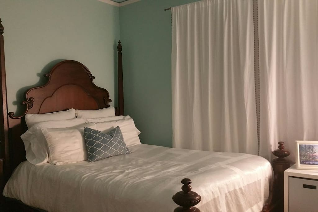 Master bed room with comfortable bed and silky soft sheets.