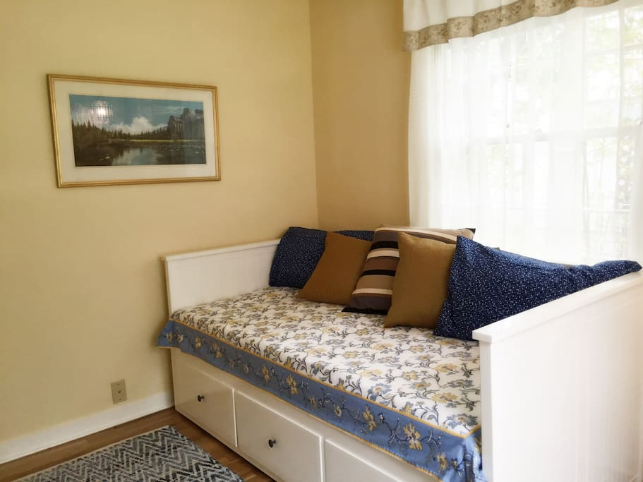 Beautiful twin day bed  pulls out to make a comfortable queen to sleep 2.