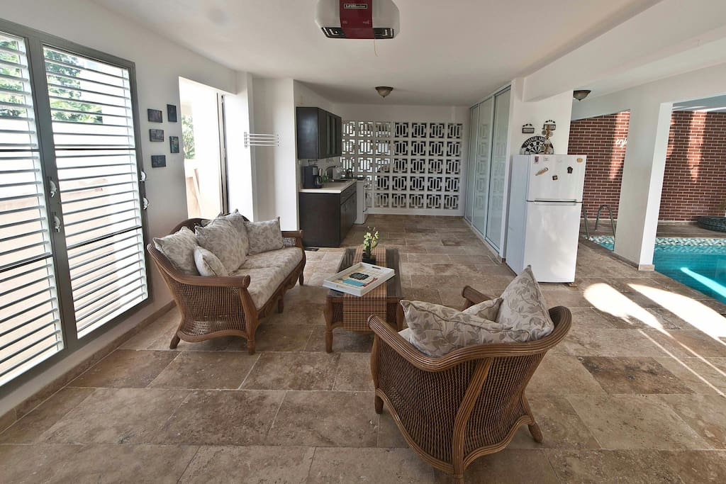 At entrance, at your left, sofa and kitchen area