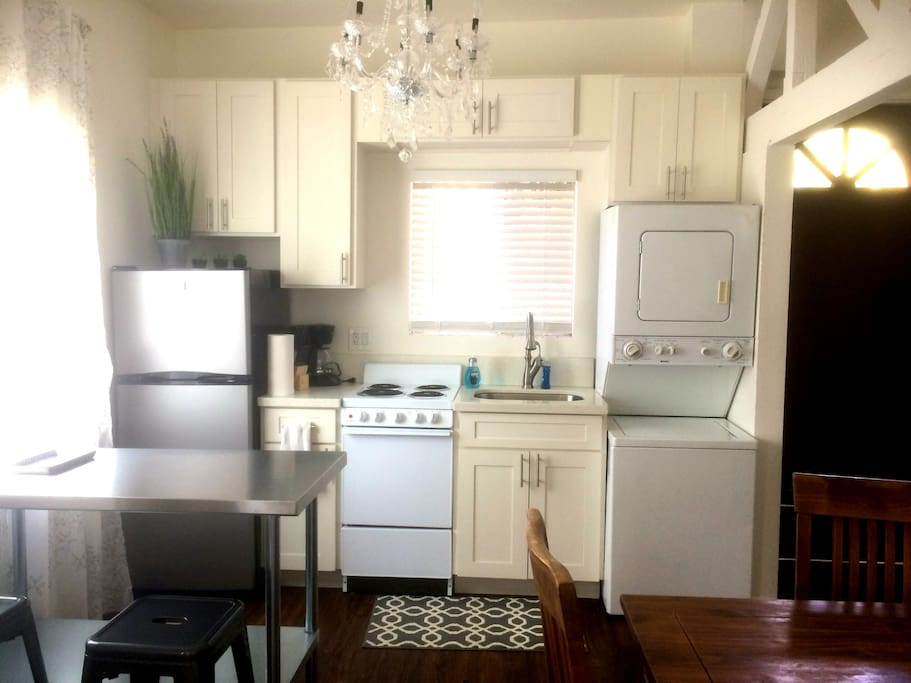 Kitchen with fridge, microwave, stove/oven, coffee maker, toaster, plates, glassware, utensils, everything you need for a comfortable stay.  Also have a private washer/dryer in unit.
