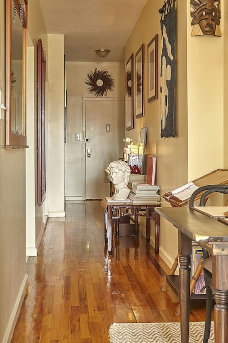 redecorated hallway with partial view of dining table for two