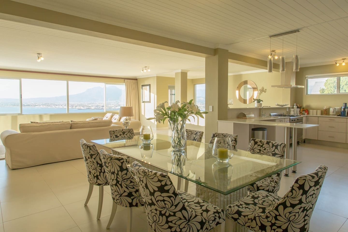 the main lounge with dining area and open plan kitchen overlooks False Bay