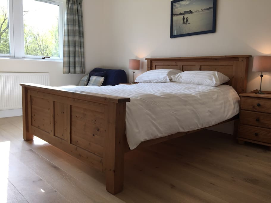 Warm, cosy room with a king sized bed and a separate pull out chair bed