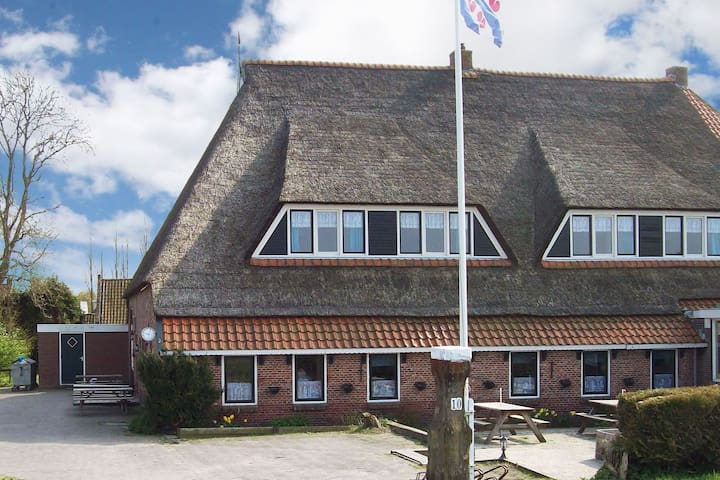 Group apartment on the Wadden coast of Friesland, in the  village Holwerd.