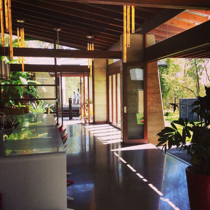 Spacious Main pavilion, perfect for events, opening out to landscaped gardens, a covered day bed area and lawned areas