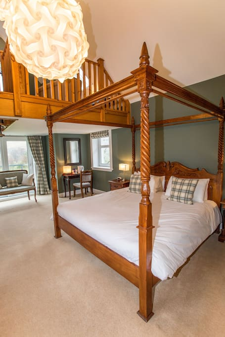 A sumptuous super-king four-poster bed