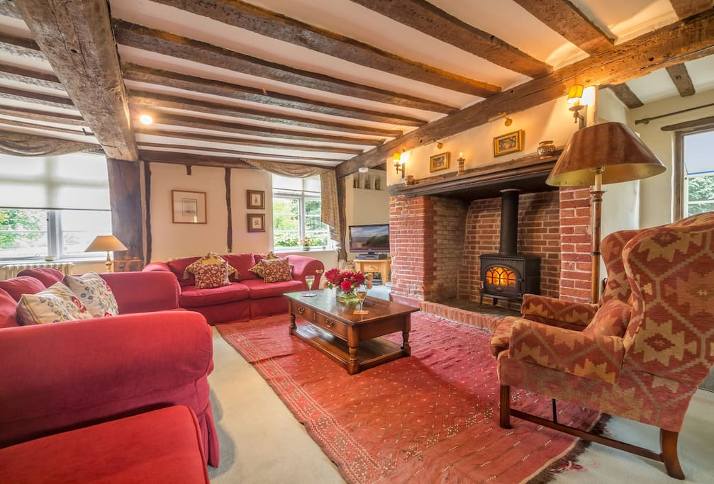 Ground floor: Sitting room with  original features including the exposed beams,  and a beautiful inglenook fireplace