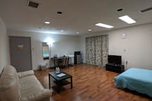 Living room, door leads to common area and lobby