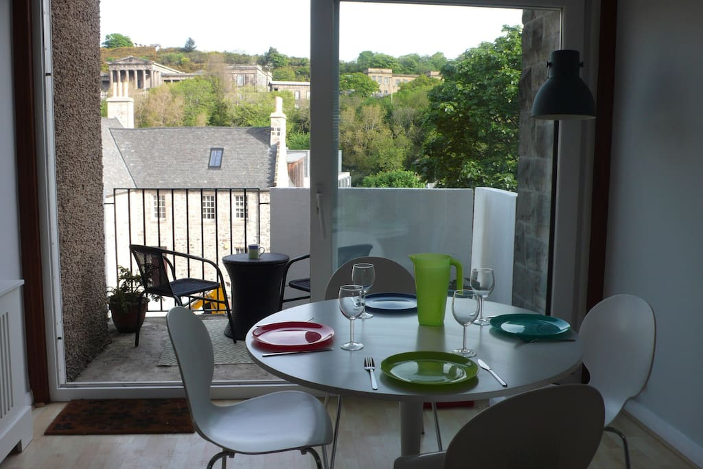The dining area opens out to the private balcony with spectacular views of some of Edinburgh's most famous landmarks on Calton Hill