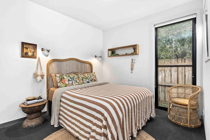 Bedroom with queen bed and French flax linens.