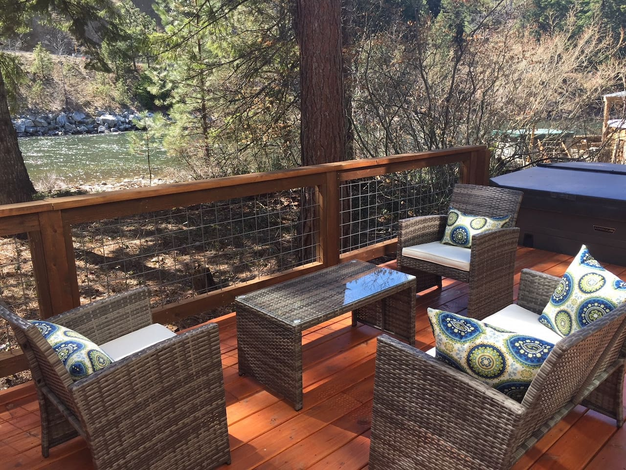 Relax on the deck or soak in the hot tub while the river floats by