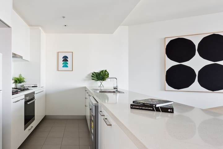 Shop at the local South Melbourne market and cook a meal in your expansive kitchen
