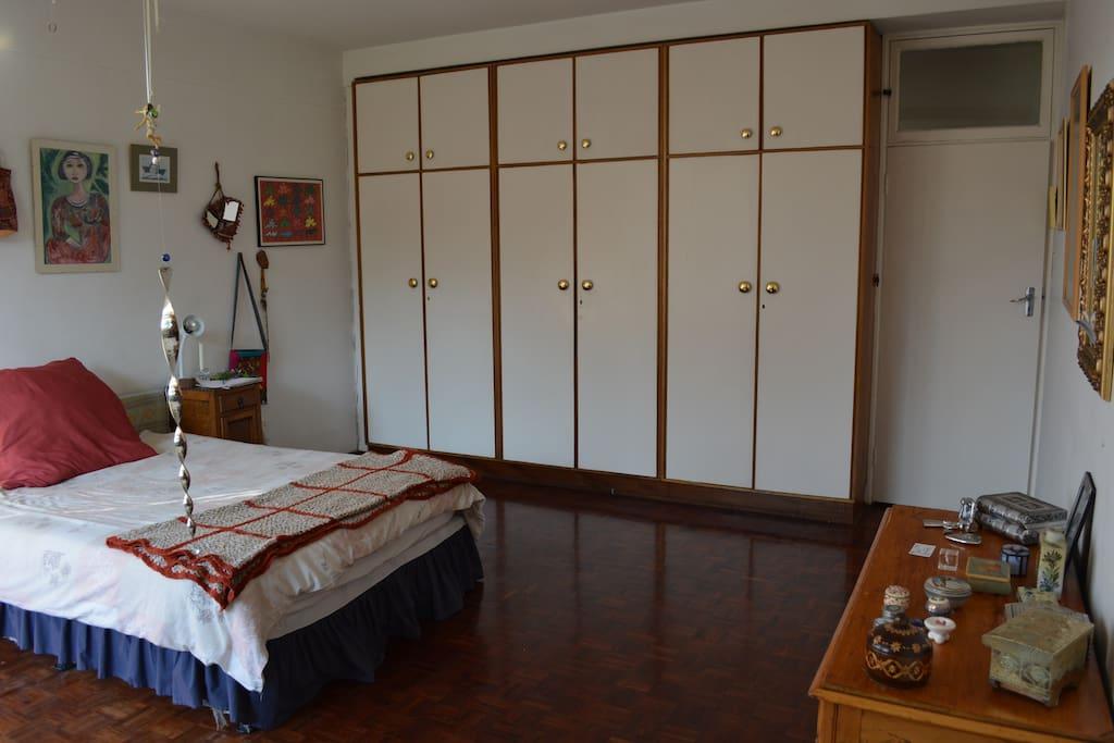 Sunny master bedroom in upscale neighborhood