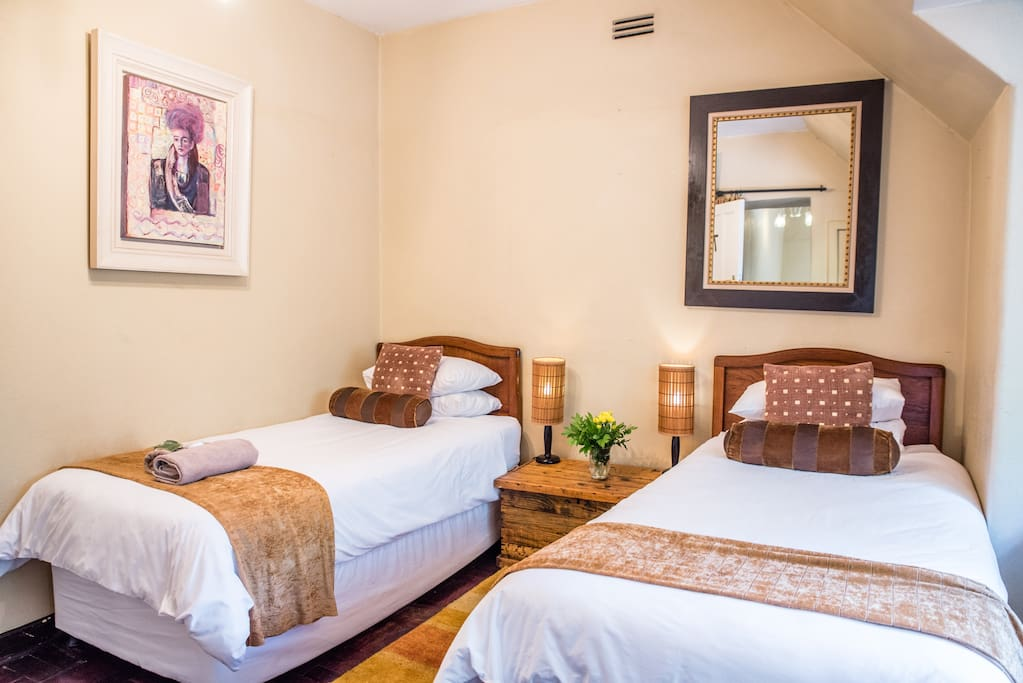 The room with 2 single beds