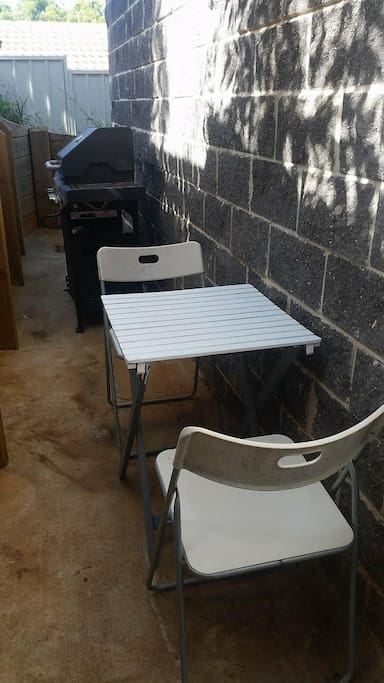 Barbeque area with outdoor setting
