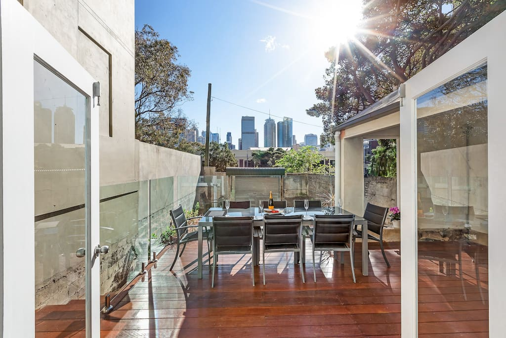 """Unwind on one of the largest terrace balconies in Darlinghurst at the outdoor dining table with private uninterrupted views to the city and secure parking for 2 cars.  """"Paul was an amazing host, so warm, friendly and helpful! We had an amazing time at this place which is stunning, breakfast on the terrace was a gorgeous way to start the day.""""- Sally Hankin *****"""