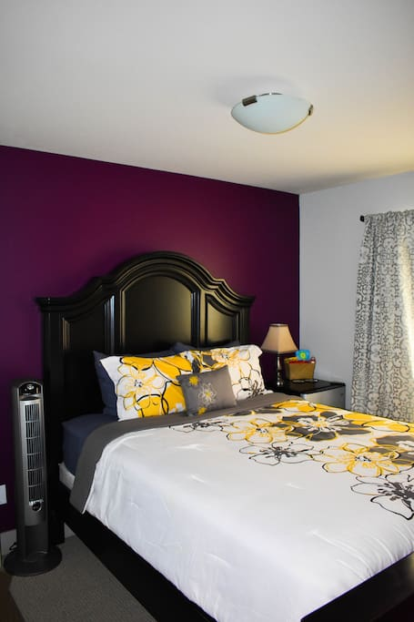 Relax on a plush queen bed and sleep in with room darkening curtains!