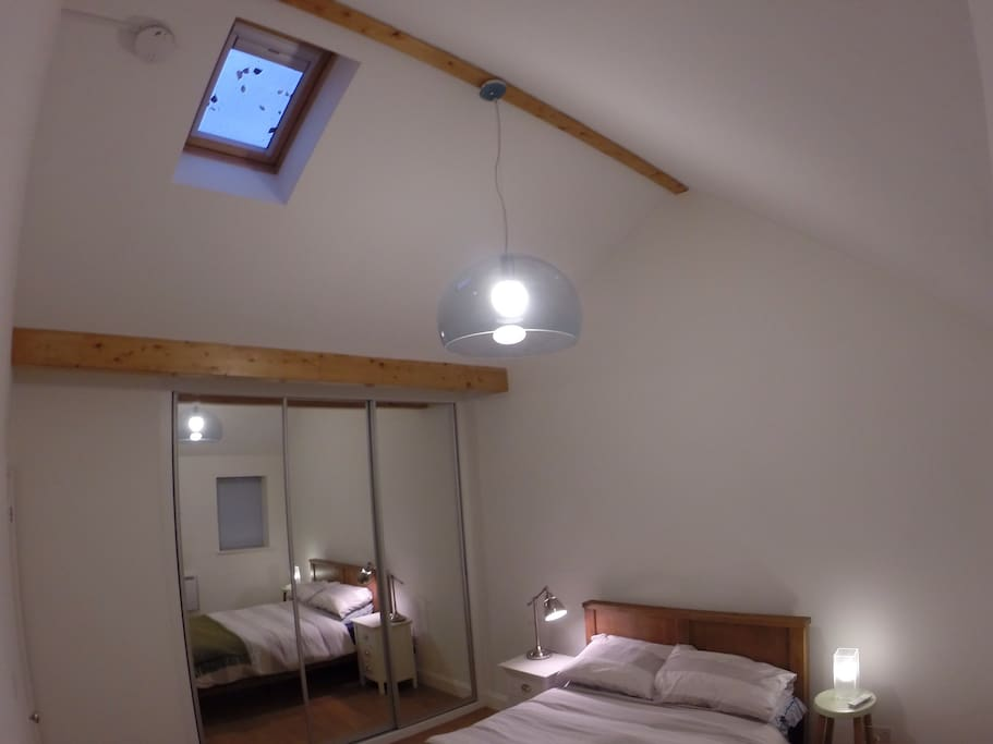 Double bedroom with remote controlled roof blind.