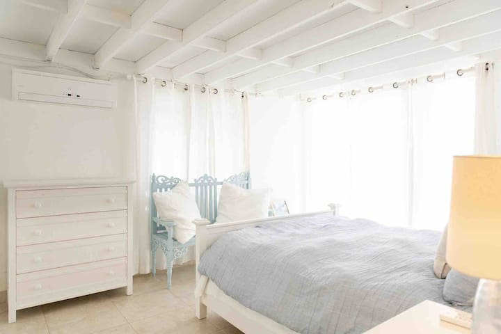 Guest bedroom with ocean views and breezes.