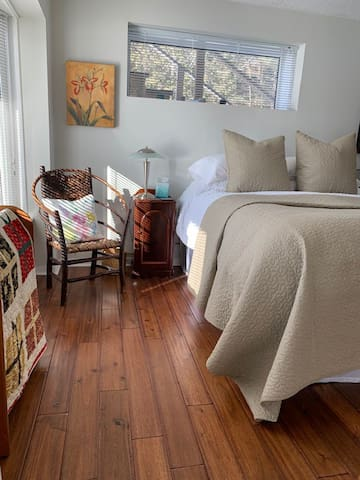 Country apt bedroom with queen bed