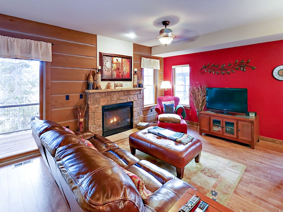 """A gas fireplace and 42"""" flat screen TV feature in this cozy sitting room. Professionally cleaned and maintained by TurnKey Vacation Rentals."""