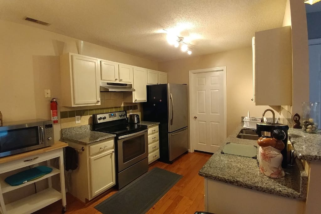 Guest access to microwave, range, refrigerator, dishes, dishwasher, coffee and tea bar. View also show entrance to laundry room.