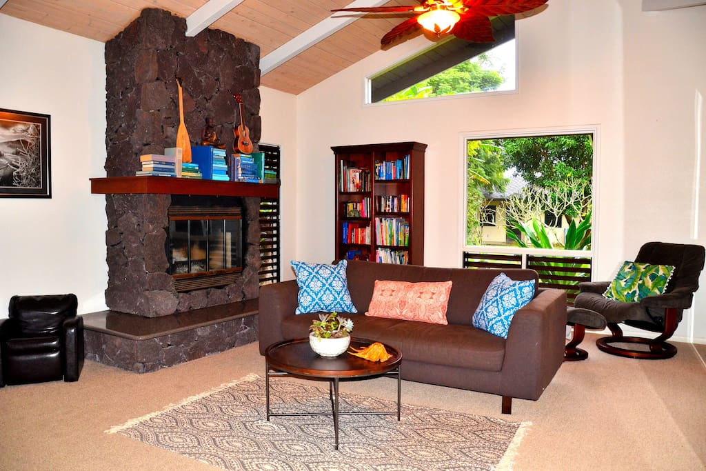 "Family Room with Fireplace and 55"" Wall-Mounted Flat Screen TV"