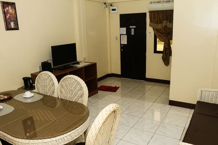 Room 2 is a Suite Room with separate bedroom and living room