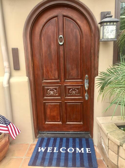 we Love the architectural carved wood front door!