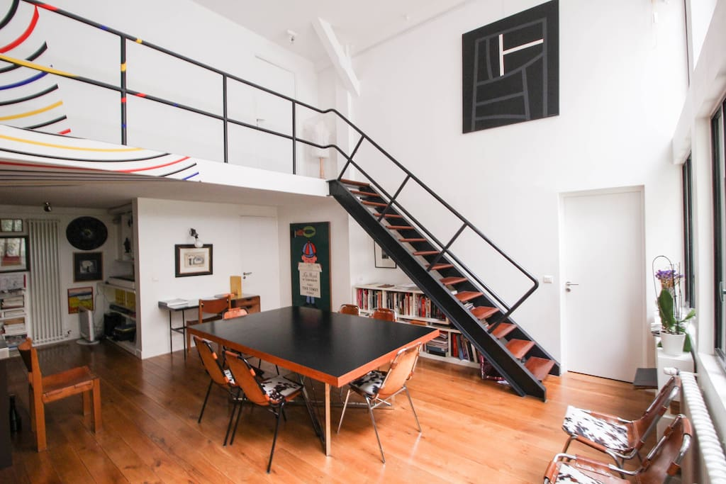 Dining table for 8 and stairs to first floor