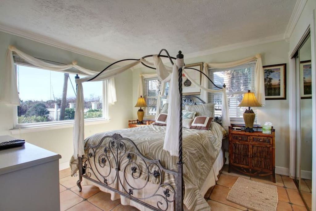 Beautiful Bedroom with Stunning Decor and Ample Sunlight Shining in!