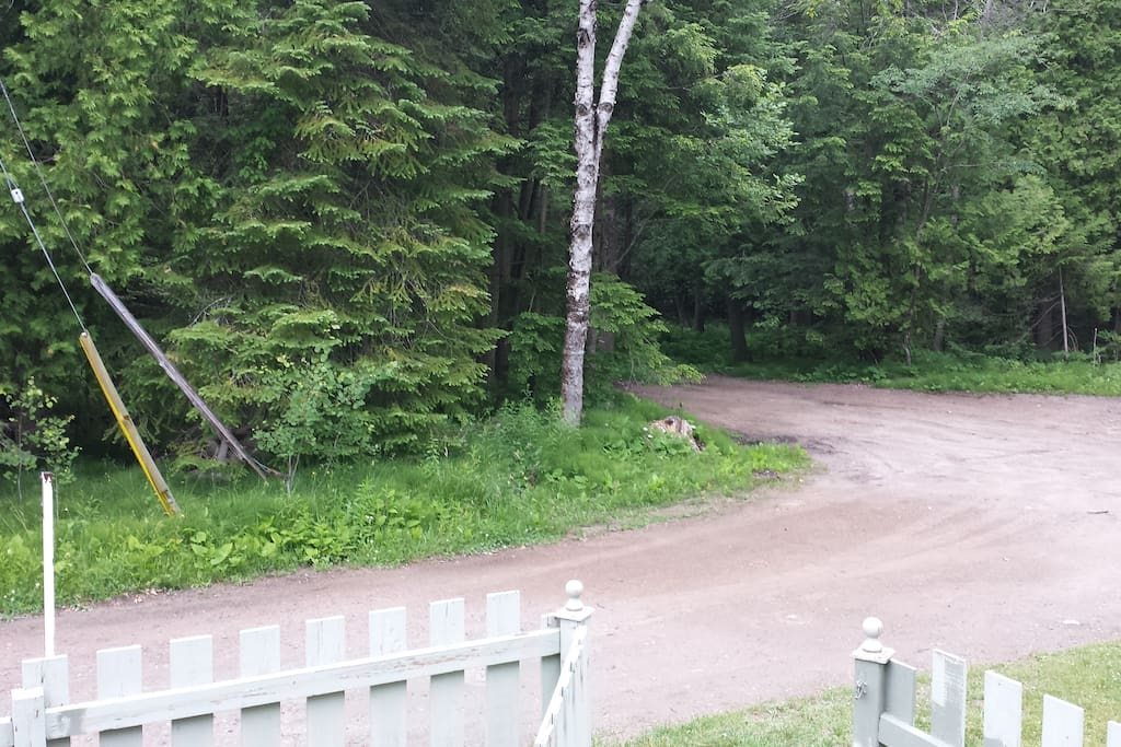 view from front porch, with fenced in front yard.