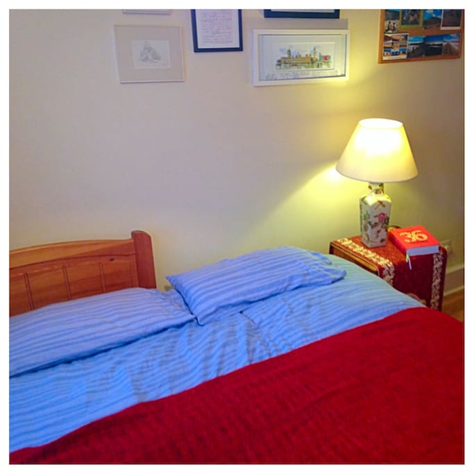 This photo shows our air bnb room with a double bed. We will provide clean sheets and towels. The mattress is super comfortable!