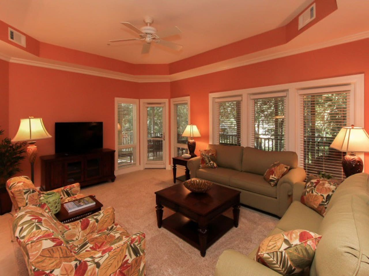Living Room with Screened in Porch Access at 8134 Wendover Dunes