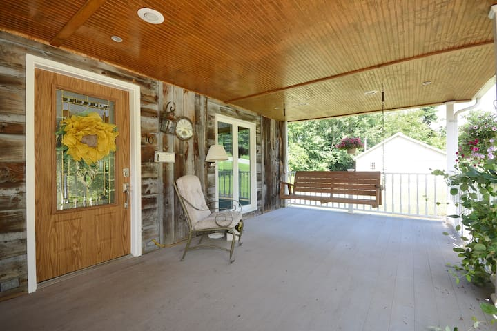 Inviting front porch with swing