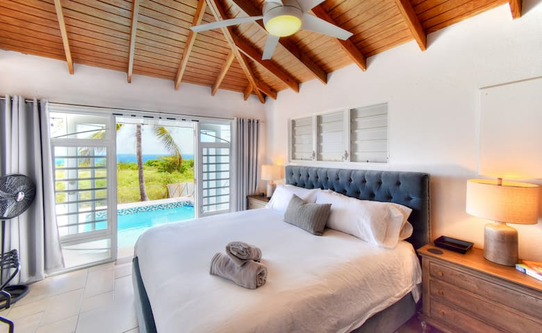 Wake up each morning with a view of the ocean from the king bed in the master suite.