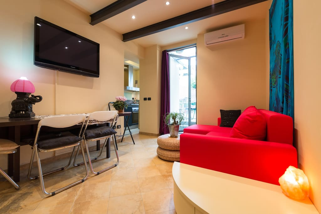 The living room with TV and air conditioning