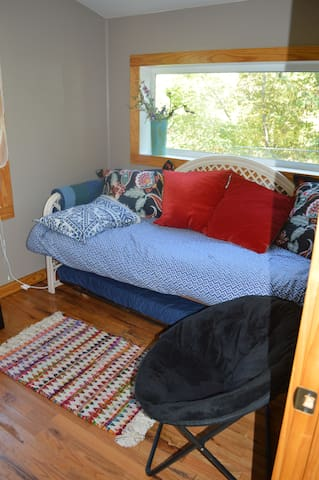 Trundle bed Can pull out another single that pops up and can be used like a queen also if you want. TV in this room with basic channels and DVD and videos in drawer. River view!