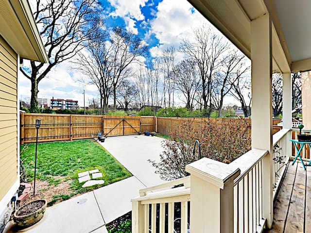 Find a private parking pad in the fenced backyard.
