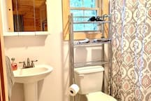 Full bathroom with shower and tub is right off the bedroom.