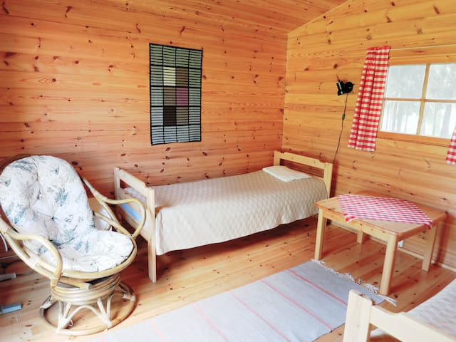 Tidy B&B cabin on a lakeside farm