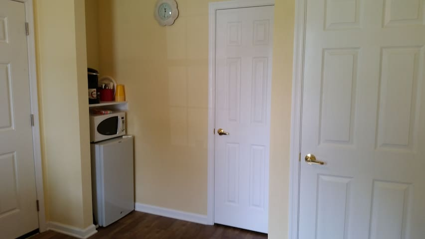 The refrigerator, microwave, and coffee maker are ready for your use.