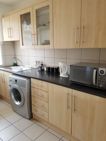 Fully equipped kitchen with fridge, microwave, oven, hob & washing machine