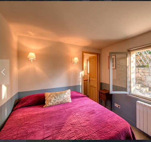 Bedroom one with double bed and en-suite bathroom.