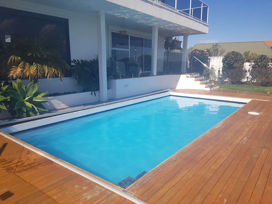 Geo-thermally heated pool