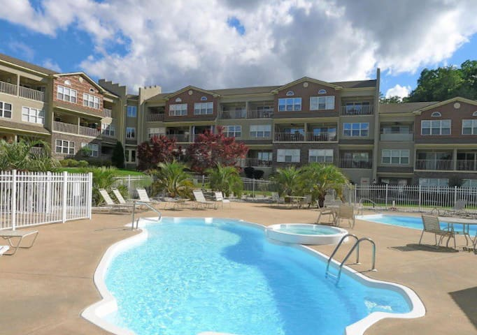 Your children will enjoy these pools! There's a playground directly to the right. There are grills along the water with picnic tables.