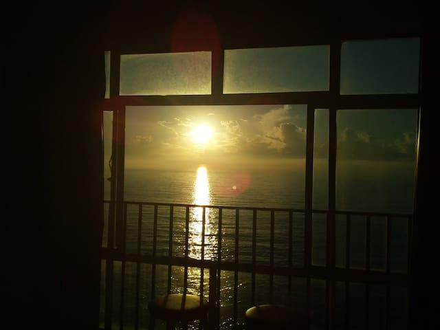 Vista mar, nascer do sol